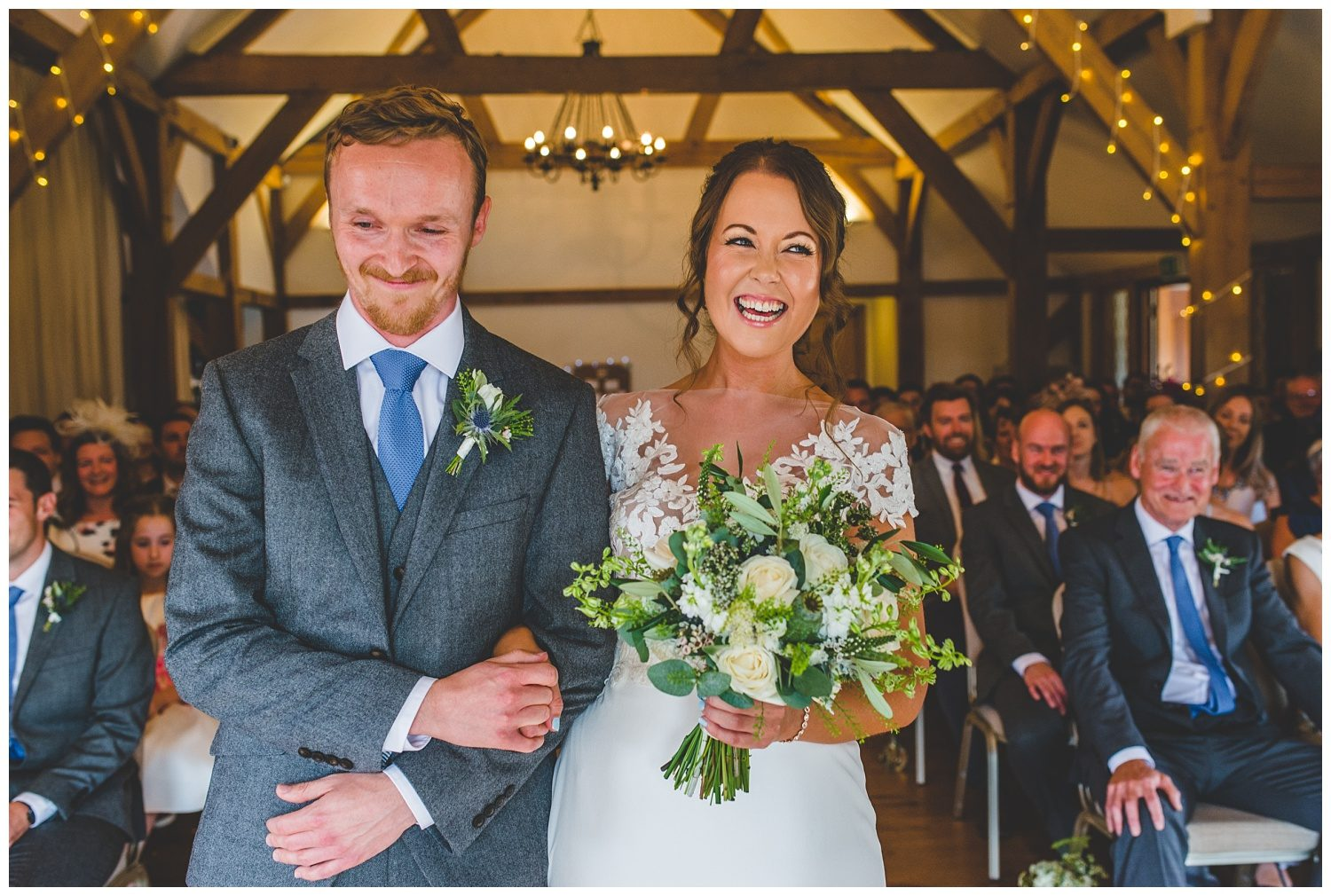 Happy couple in Sandhole Oak Barn wedding ceremony room