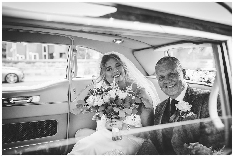 bride and dad in wedding car