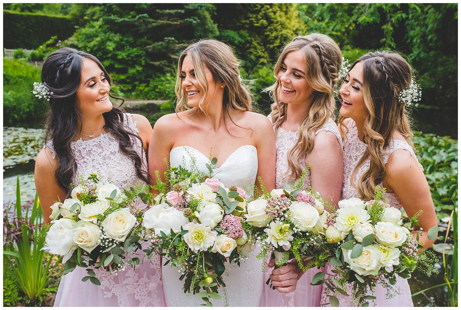 Beautiful bride and her bridesmaids in pink