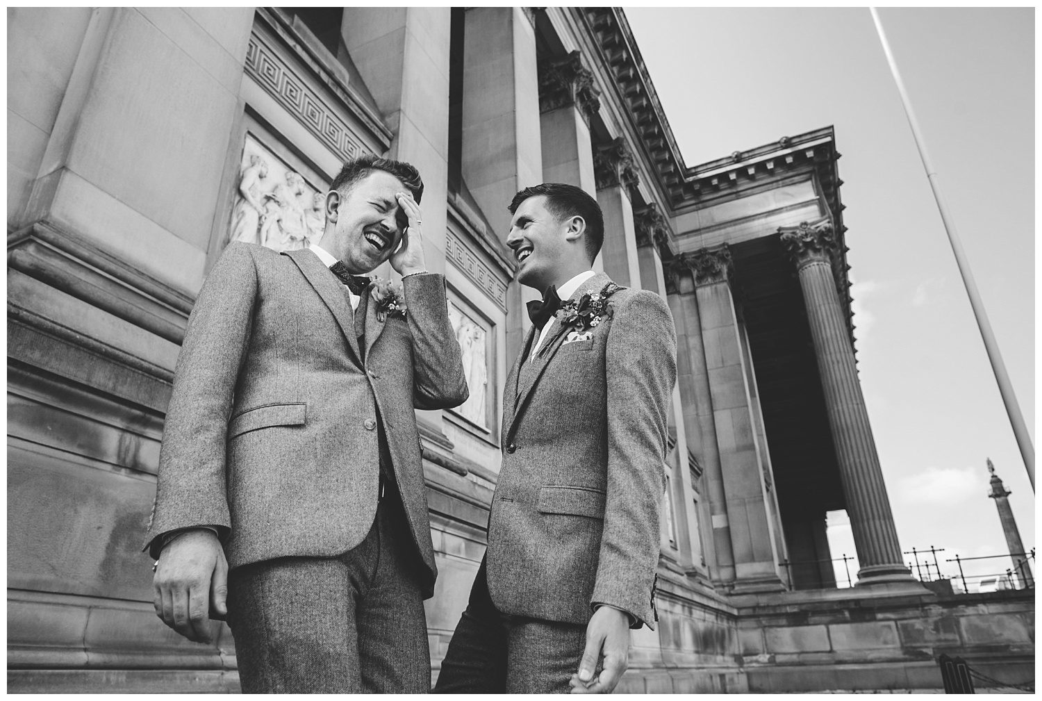 Two grooms laughing on their wedding day