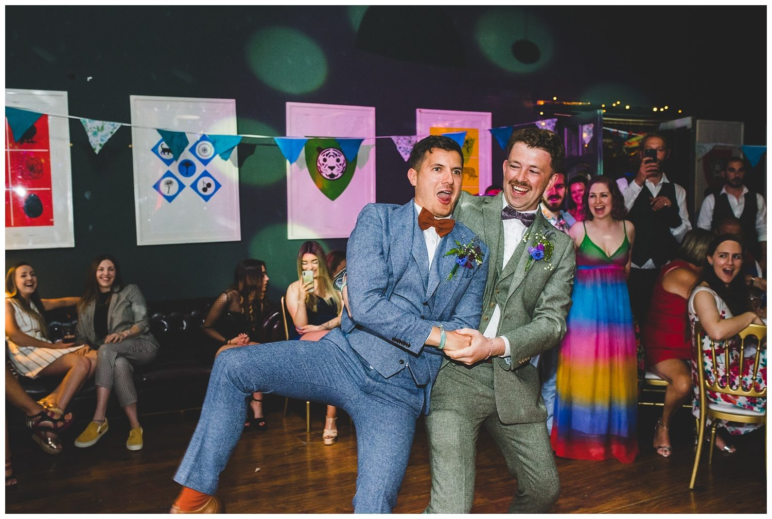 Two grooms dancing at their Leaf Liverpool wedding