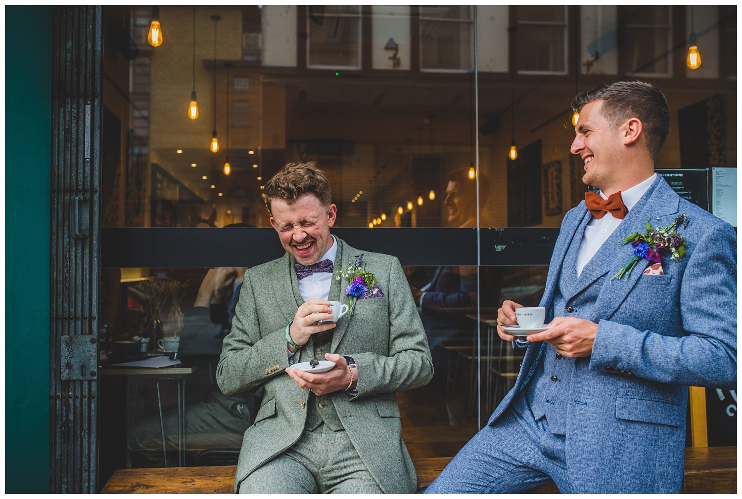 Two grooms laughing in Liverpool