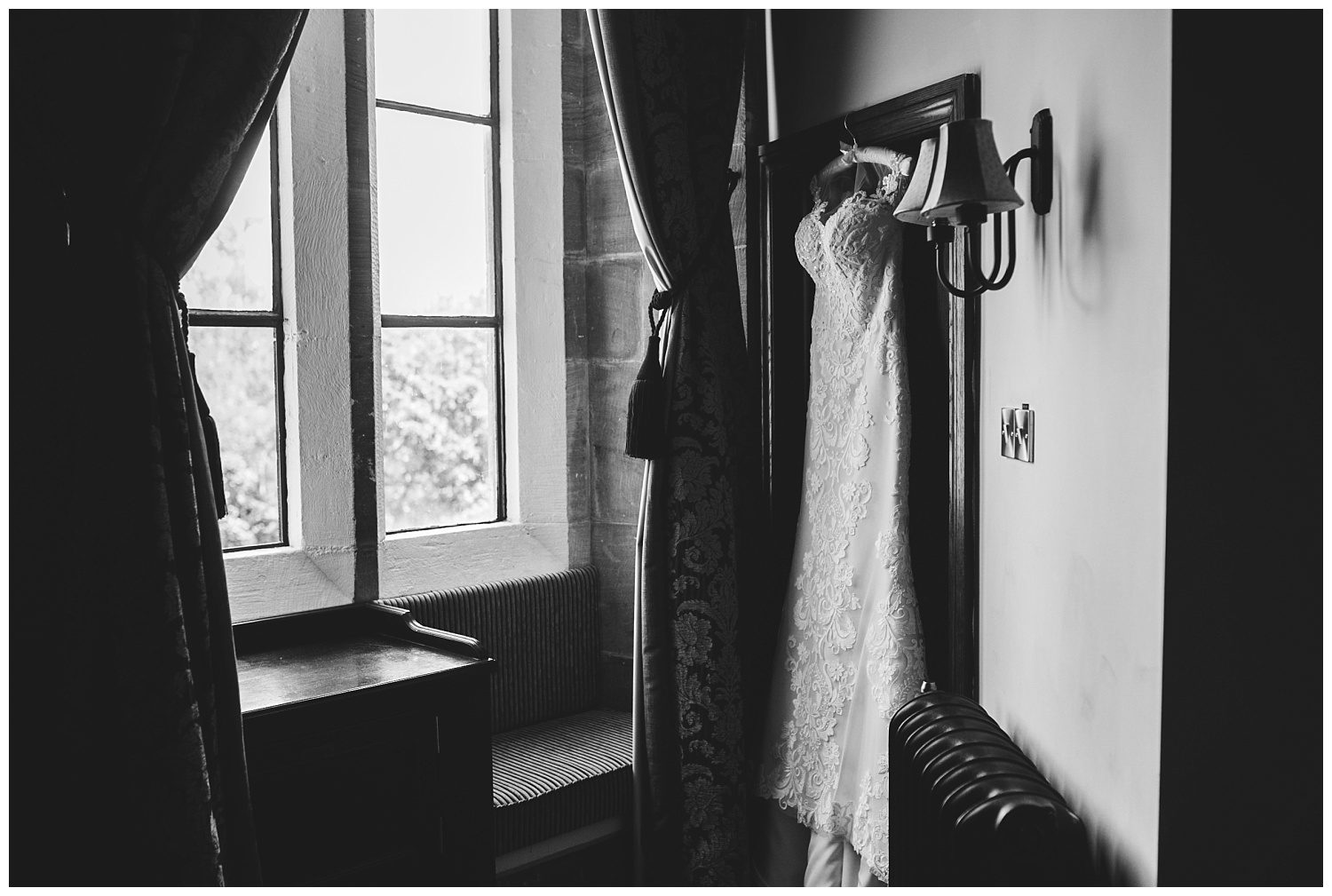 wedding dress hanging up in Peckforton Castle