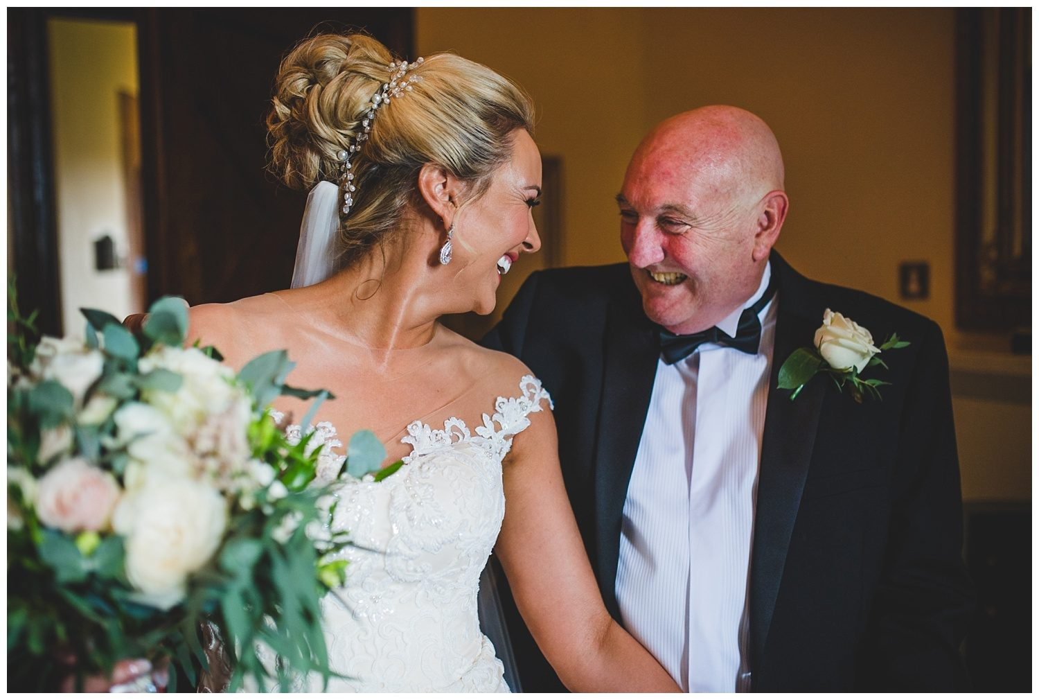 Bride and her father laughing before the ceremony at Peckforton Castle