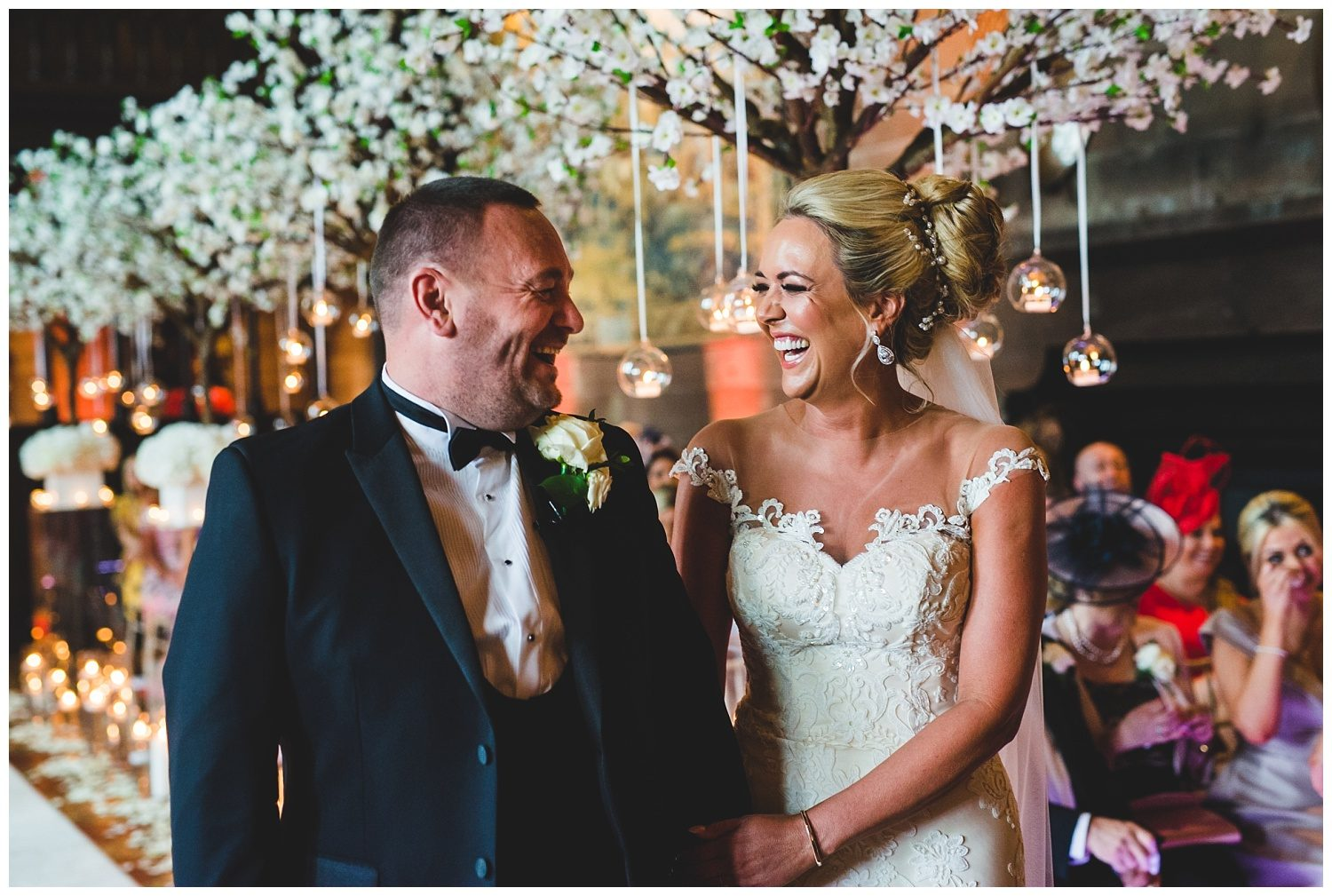 Laughing bride and groom during their Peckforton Castle wedding ceremony