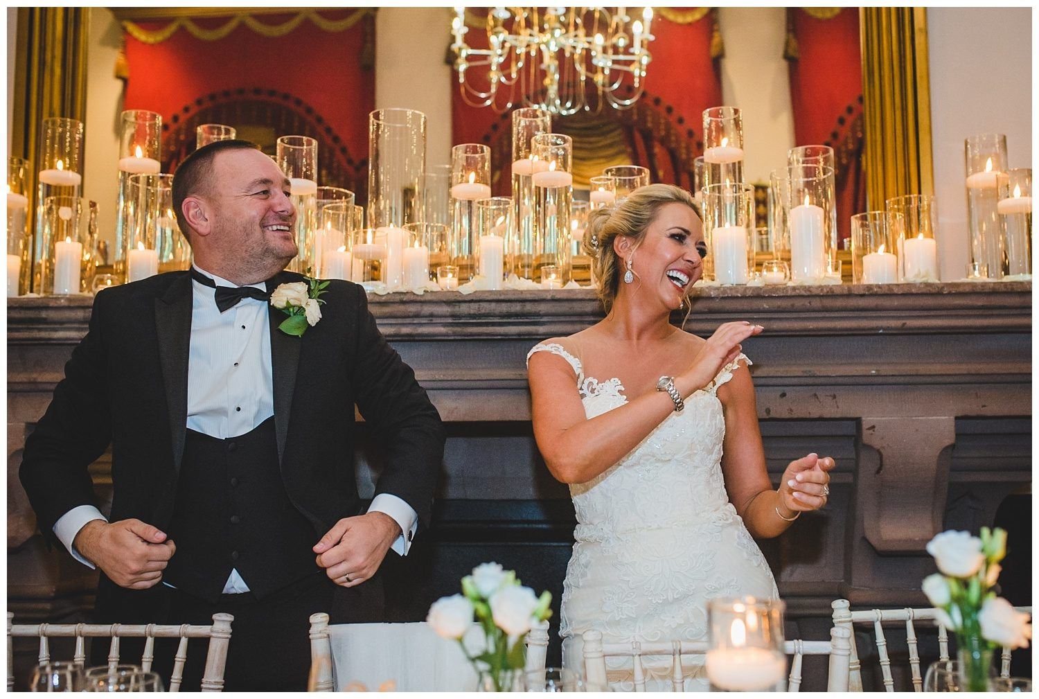 Bride and groom laughing at their Peckforton Castle wedding