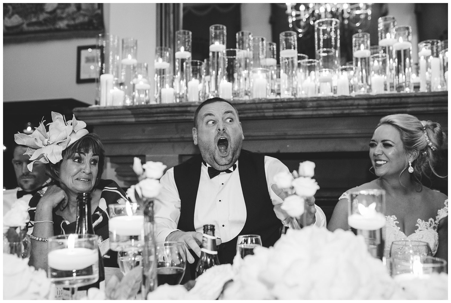 Groom laughing during his Peckforton Castle wedding speeches