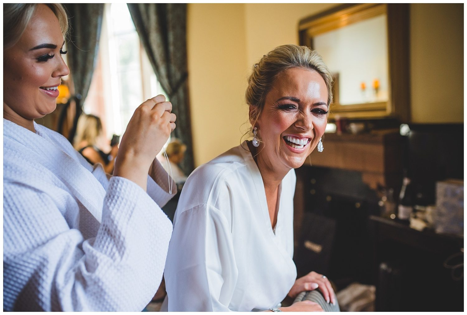 Laughing bride at her Peckforton Castle wedding