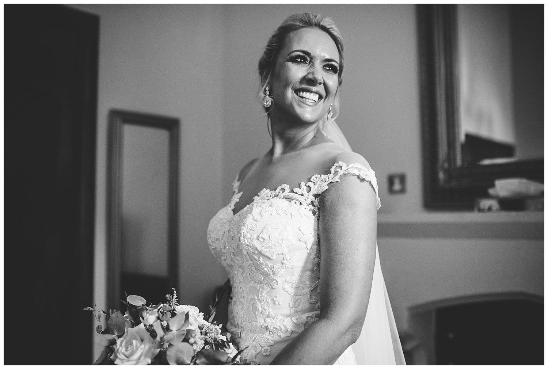 Beautiful bride in her wedding dress at Peckforton Castle