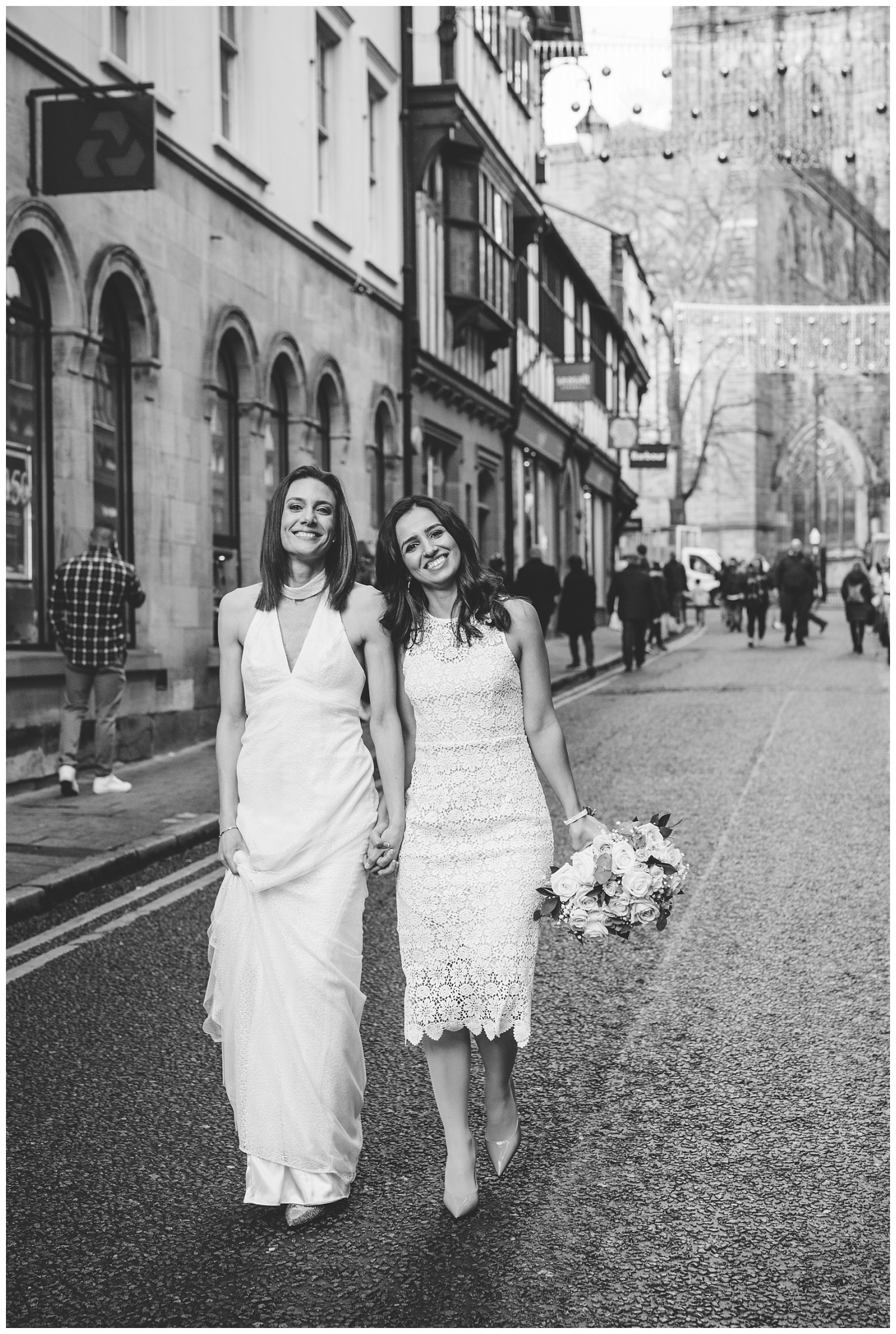 Two brides walking through Chester